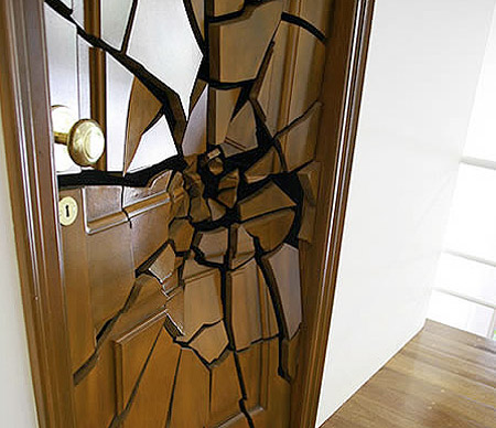6 of the world 39 s coolest door designs techeblog for Wooden door ideas