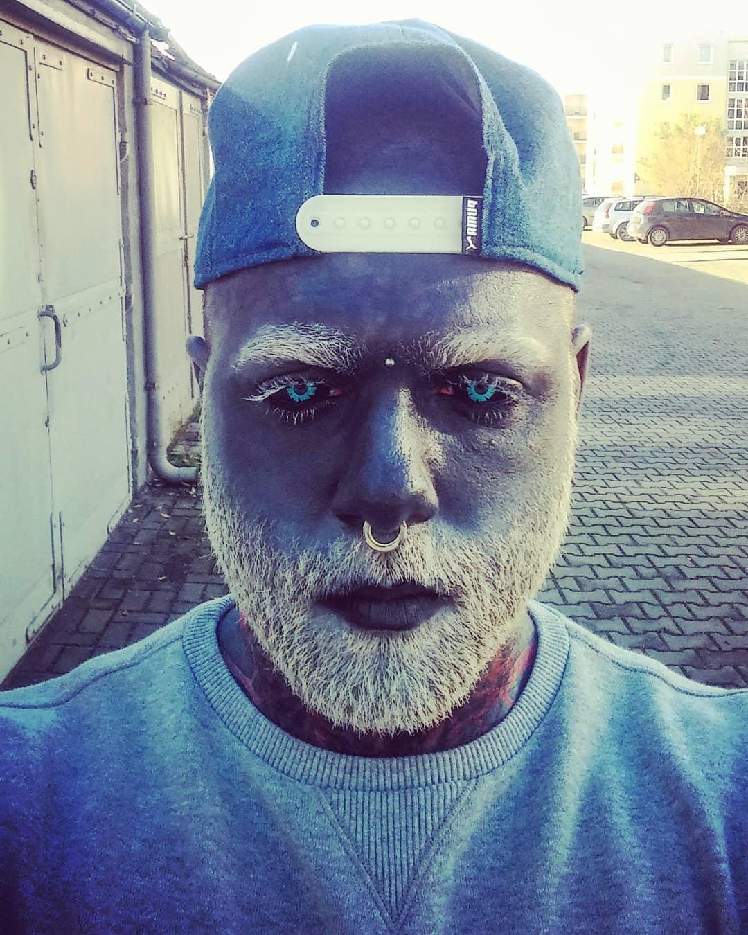 Man Tattoos Face Gray