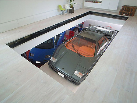 Incredible home features underground garage with supercar for Underground garage design plans